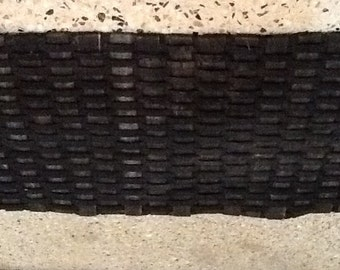 """Doormat made from Recycled Bicycle Tyres.  A whole new meaning to """"Recycling"""""""