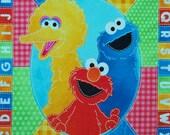 "Sesame Street cotton panel -- approximately 35"" x 44"""