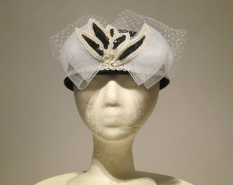 Women's Black and White Satin Pillbox Dress Hat With Floral Design