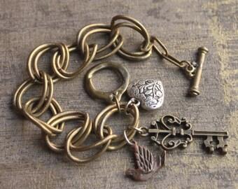 Vintage 80's Charm Bracelet-Double Links-Repousse Heart-Dove-Faux Victorian Key Charm-T bar Toggle Clasp
