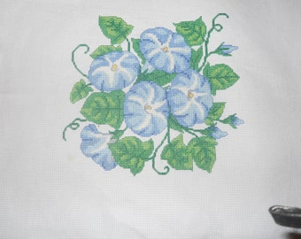 Finished counted cross stitch ready to frame.Cheery blue and white Morning Glories.