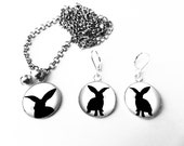Short necklace and earrings. Small black rabbit on white background. Cabochon round dome glass bells. reduced price -25%