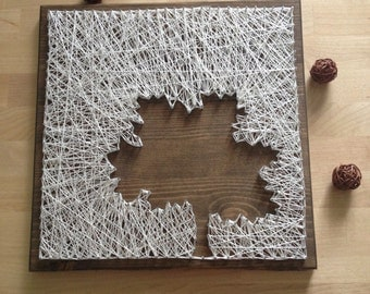The silhouette of the tree executed in technique String Art