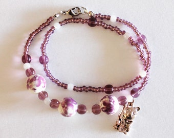 Bracelet with beads and maneki neko charm