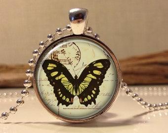 Butterfly on vintage postcard necklace.  Butterfly art pendant jewelry.