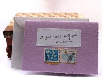 A good heart's worth gold Blank card with handwritten quote and postal stamps