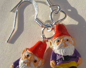 petite ceramic gnomes from Peru wearing yellow and purple pierced dangle hand made wire wrapped earrings