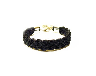 Black braided nautical rope bracelet with silver anchor charm