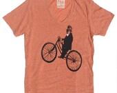 V-Neck T Shirt, Monkey on Bike, in Unisex Heather Peach