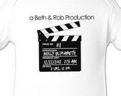first baby pregnancy announcement - adorable clapboard bodysuit for announcing a new baby
