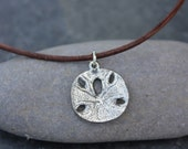 Sand dollar necklace - pewter sanddollar charm on a distressed brown leather cord - men's or women's - free shipping USA