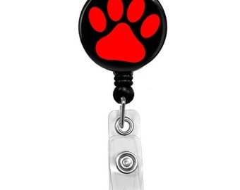 Red Paw Print on Black Mylar Covered Badge Reel
