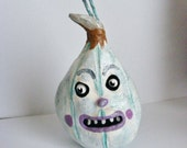 Frozen Glittered Folk Art Pumpkin Christmas Ornament