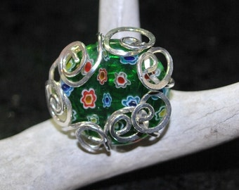 Flowers and Silver Ring