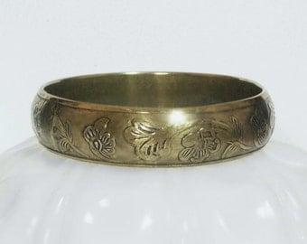 Vintage Brass Bangle Bracelet With A Raised Etched Design.