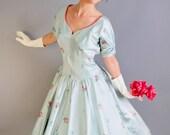 1950s Pastel Blue Roses Print Party Dress. Formal Dress. Audrey Hepburn. Mad Men Fashion. Wedding Bridesmaid. Fall Fashion