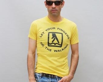 80s vintage Yellow Pages t-shirt, yellow, distressed, outdated, relic, slogan, advertising