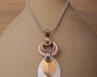 Athena necklace, large, unisex: hammered copper washer, stainless steel and bronze scales, silver and copper rings