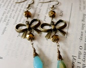Cute bronze bow earring with matching bronze and teal blue glass bead accents, All A-Bow-t You Dear