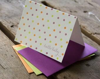 Dots hello baby letterpress cards, in orange, purple & green letterpress printed card. Eco friendly
