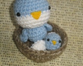 Mama and baby Bird and eggs in a cozy Nest