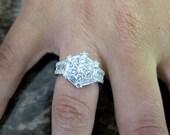 18K White gold Diamond Cluster ring.
