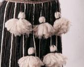 Tribal Tassel String Belt In Black, Brown, Cream, and beige tones
