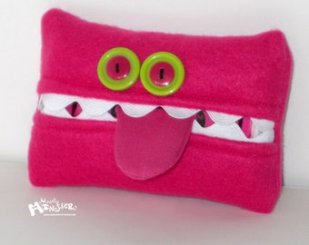 Kleenex Kreatures will hold your pocket-sized tissues.....Hot Pink Magenta