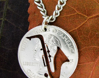 Saxophone necklace, Cut by hand from a quarter
