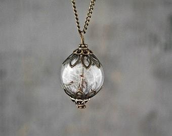 Real Dandelion Seeds Antique Style Bronze. Handblown glass orb, double bronze bead cap, long necklace