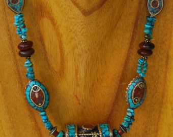 Four Sided Brass Tibetan Bead embedded with Copal and Turquoise and Highlighted with Nepalese Beads and Turquoise