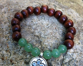 Yogi inspired wood bead bracelet with flower charm and soft green glass beads