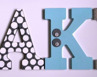 A Set of 4 Hand Painted Wooden Letter Wall Hangings