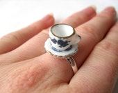 Ceramic tea cup ring with blue flower pattern