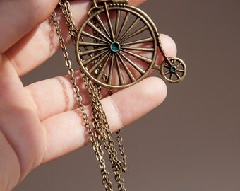 Necklace with velocipede pendant, retrò farthing, vintage style.