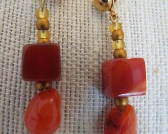 "Earrings made of Carnelian semi prescious gemstones, and gold tone wire 2 1/4"" dangle. ."