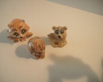 Miniature ceramic raccoon, dog and lioness