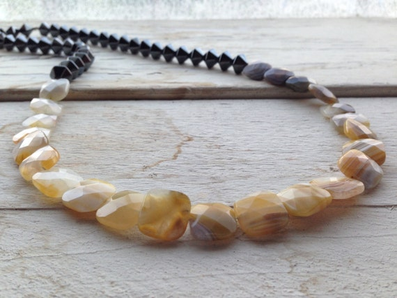 Exclusive necklace with semiprecious stones, hematite and yellow Botswana agate. Unique piece handmade.