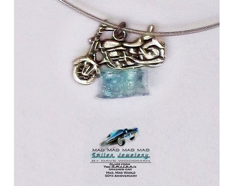 "Authentic movie artifact motorcycle charm choker made with ""It's a Mad, Mad, Mad, Mad World"" car glass."