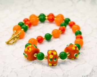 Orange & Green necklace with Lampwork floral beads