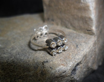Sterling silver ring set with 6 diamonds
