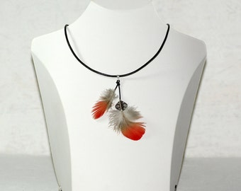 Collar leather with two red parrot feather.
