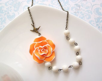 Bright Statement Necklace. Bright Neon Orange Clay Rose Ivory Pearls with antiqued brass flying swallow bird Antiqued Bronze Necklace