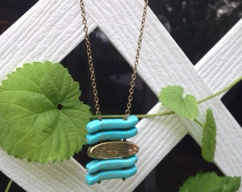 Turquoise stone and brass necklace
