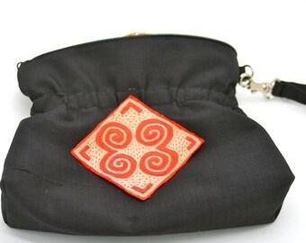 Hilltribe motif wristlet
