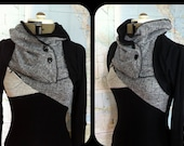 black lightweight sweater with buttoned cowl and asymmetric color panels. thumbhole sleeves and tiny stash pocket.