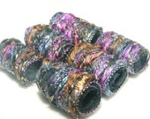 She says in order to understand fiber beads you have to appreciate color and glitter. Understand this. tube bead, barrel bead, scarf slide
