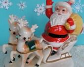 SALE....Vintage Super Cute Ceramic Santa and Reindeer Sleigh Figurine