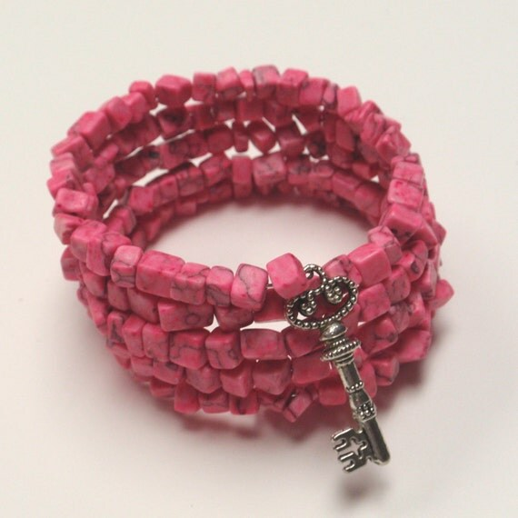 Pink cube bead memory wire bracelet with key charm