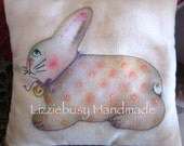 Primitive stitchery bunny cookie cutter pillow colored with Derwent Inktense watercolor pencils